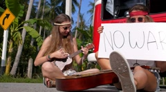 Boho Rebellion Hippie Girls with No War Sign on Road Stock Footage