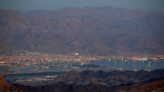 Evening view from Eilat mountains to aqaba gulf, Israel. Panning shot Stock Footage