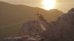 View of the catholic cross and rope ladder over the abyss Stock Footage