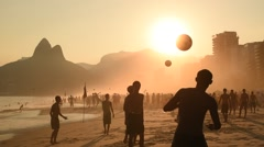 Beach Football by Sunset Stock Footage