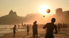 Beach Football by Sunset - stock footage