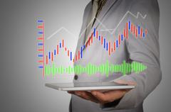 Business Man Analyze Graph on Mobile Tablet or Wireless Device Stock Photos