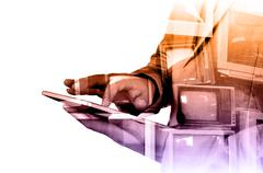 Double exposure of Business Man use Mobile Tablet with Television display as  - stock photo