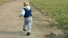 Child kid baby toddler boy is running, slow motion Arkistovideo