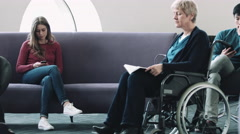Doctor consulting patient in hospital waiting room Arkistovideo