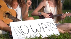 Hippie Girls With Sign Anti-War Protest Outdoors. Slow Motion Stock Footage