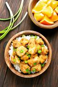 Asian dish chicken meat with orange sauce - stock photo