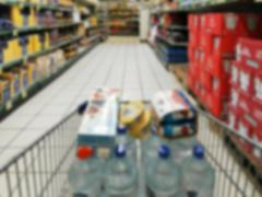 Stock Photo of blurry market and shopping cart