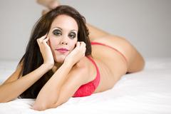 Beautiful attractive female body in erotic red lingerie Stock Photos