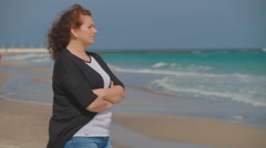 Two girlfriends , sisters walk along the shore of the Black Sea Stock Footage