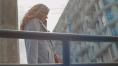 Girl walking in an unfamiliar big city Stock Footage