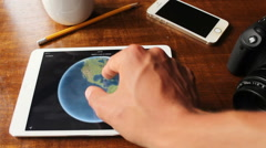 Young man scanning Phoenix, Arizona with Google Maps on his iPad Stock Footage