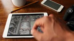 Young man scanning San Antonio, California with Google Maps on his iPad Stock Footage