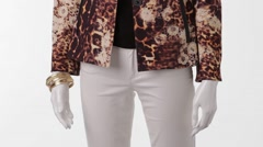 Mannequin in leopard jacket turning. Stock Footage