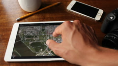 Young man scanning Washington D.C. with Google Maps on his iPad Stock Footage