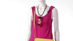 Rotating mannequin in pink top. - stock footage