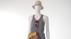 Rotating mannequin in striped top. - stock footage