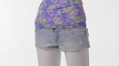 Mannequin in denim shorts turning. Stock Footage