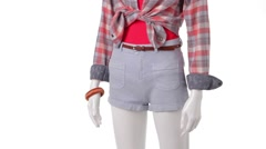 Rotating mannequin in gray shorts. - stock footage