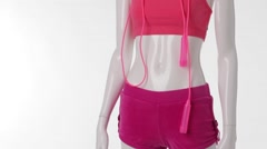 Pink sport shorts on mannequin. Stock Footage