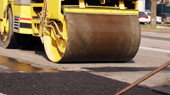 Heavy Vibration roller compactor at asphalt pavement works for road repairing Stock Footage