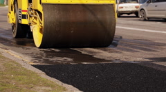 Steamroller, road roller  at a road construction site - stock footage