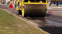 Asphalt roller working on the street that was recently repaired. Stock Footage