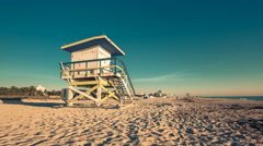 Sunrise above Lifeguard Hut in South Beach, Miami Stock Footage