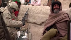War in Afghanistan - United States Army Medic aids a local Afghan farmer Stock Footage