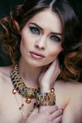 Beauty rich woman with luxury jewellery looks like mature close up, bright Stock Photos