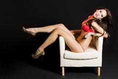 beautiful attractive female body in erotic red lingerie - stock photo