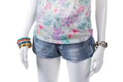 Floral top and wrist accessories. Stock Photos