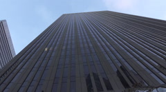 Driving around modern glassy sky high skyscrapers in big city - stock footage