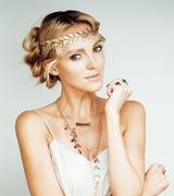 young blond woman dressed like ancient greek godess, gold jewelry close up - stock photo