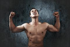 Rage scream of muscular strong man Stock Photos