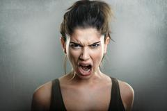 Scream of angry upset woman Stock Photos