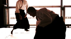 Japanese man and woman Aikido Warrior Dojo - stock footage