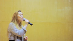 Girl Singing Into a Microphone Stock Footage