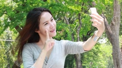 asia thai northeast adult beautiful girl using her smart phone Selfie. - stock footage