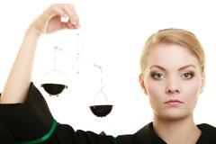 woman barrister holding scales. - stock photo