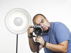 professional photographer with photographic equipment - stock photo
