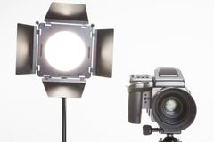 Stock Photo of medium format  proffesional camera and studio light with barn doors