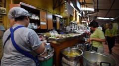 street food sellers on Bangkok night street near MBK mall - stock footage
