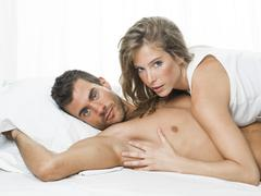 Sexy couple in white underwear having sex Stock Photos