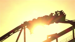 SLOW MOTION: Extreme roller coaster ride upside down looping Stock Footage