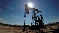 Industrial working oil pump jack pumping crude oil for fossil fuel energy Stock Footage