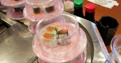 Sushi on Conveyor Belt in Restaurant 4K Stock Video Stock Footage