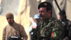 War in Afghanistan - Military leader speaking with Afghan elders at Shura Stock Footage