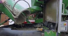 Construction site, concrete mixer poured precast cement in a concrete pump Stock Footage