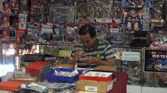 A view of an indoor flea market selling used items and collectibles. Stock Footage